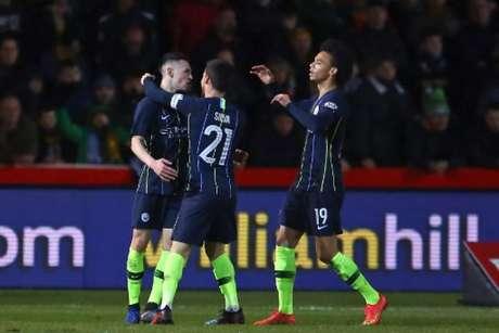 Foden (esquerda) fez dois gols para o City (Foto: Geoff Caddick / AFP)