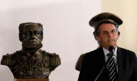 O presidente Jair Bolsonaro após se encontrar com o ministro da Defesa, Fernando Azevedo e Silva
