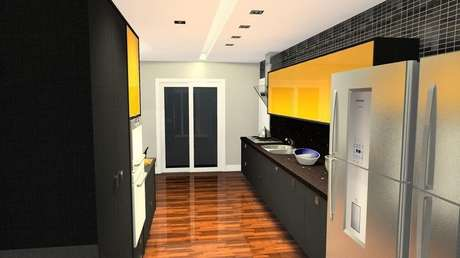 48- Combinar cores de tintas para cozinha como preto e amarelo pode deixá-la mais elegante e iluminada