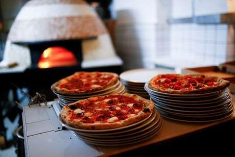 Pizza é sinônimo de felicidade para italianos
