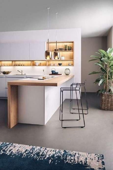 85. Decoração moderna e minimalista com banquetas para cozinha com bancada de madeira – Foto: Leicht Westchester