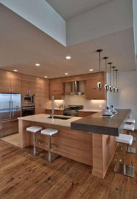 11. As banquetas baixas para cozinha são excelentes para otimizar o espaço.