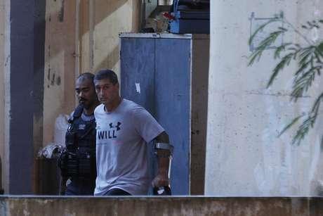 O policial reformado Ronnie Lessa, suspeito na morte da vereadora Marielle Franco e o motorista Anderson Gomes, deixa a DH - Delegacia de Homicidios, na Barra, após se negar a depor sobre o caso