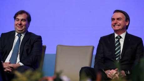 Jair Bolsonaro e Rodrigo Maia na sessão de abertura da 12ªMarcha dos Prefeitos, em Brasília.
