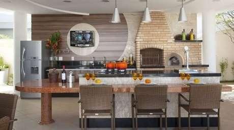 20 – Área de lazer pequena com churrasqueira estilo gourmet. Fonte: Dcore Você