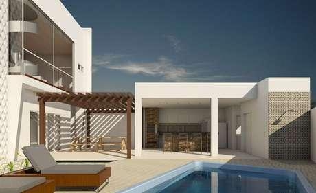 4 – Área de lazer com piscina e churrasqueira pequena. Projeto Rikelly Pessotti
