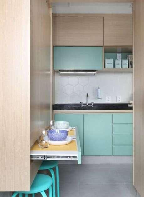 10. Decoração clean com armário verde água para cozinha planejada – Foto: Pinosy