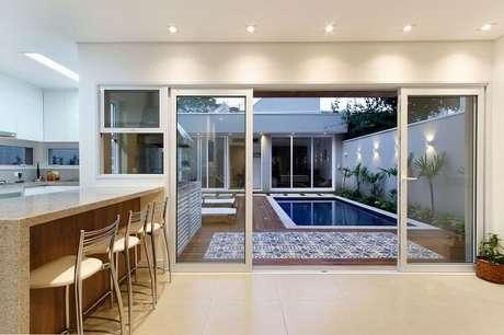 37 – Separe os ambientes com portas de vidro. Projeto de Otoni Arquitetura