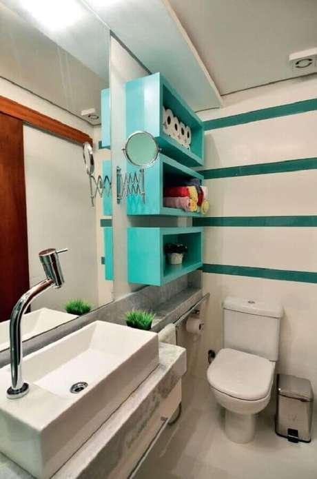 27. Decoração para banheiro clean com nicho em tons de verde água – Foto: Aaronguide