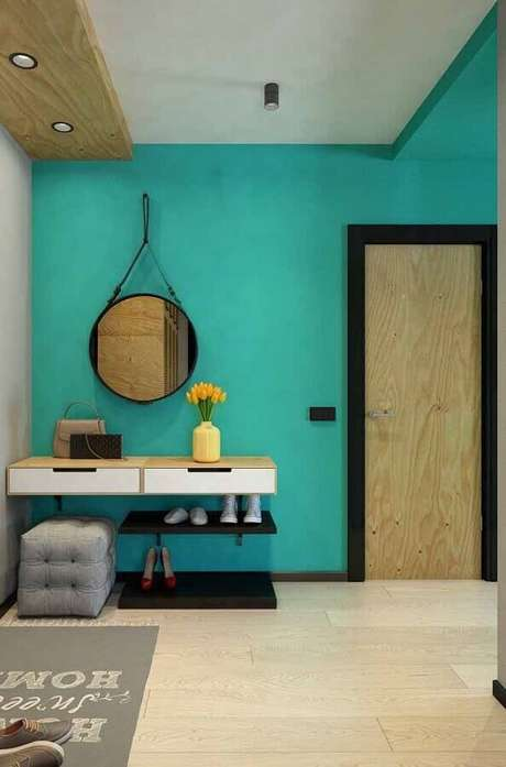 51. Decoração para hall de entrada com parede verde água – Foto: Pinosy
