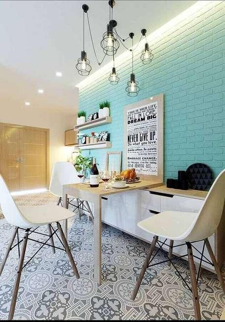 60. Sala de jantar decorada com parede de tijolinho pintada com tinta verde água – Foto: Zozu