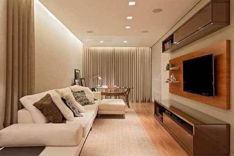 65- Os modelos de cortinas para sala de estar podem ter led´s embutidos no trilho em toda extensão da parede. Fonte: Leds Arquitetura