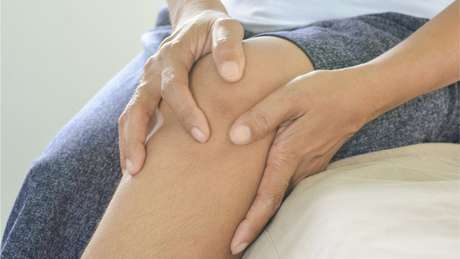 Woman holding a sore knee