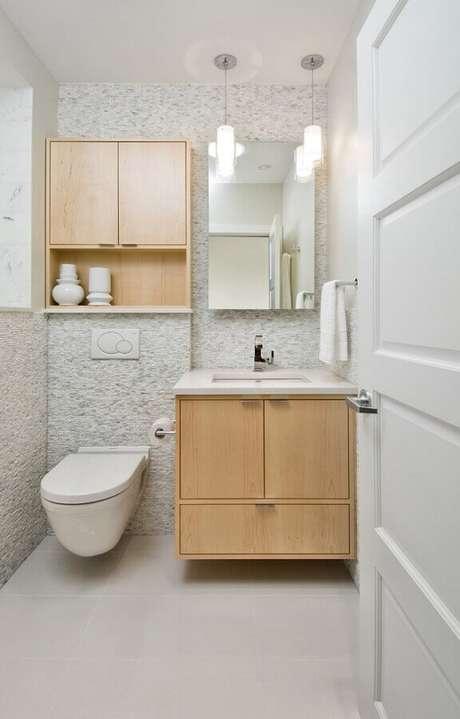24. Decoração clean para lavabo com espelheira e gabinete de madeira – Foto: Air Freshener