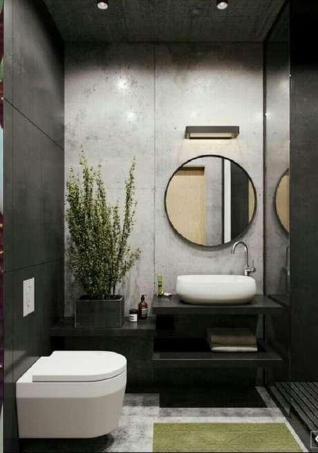 55. Decoração moderna em cinza e preto para lavabo pequeno com espelho redondo – Foto: Behance