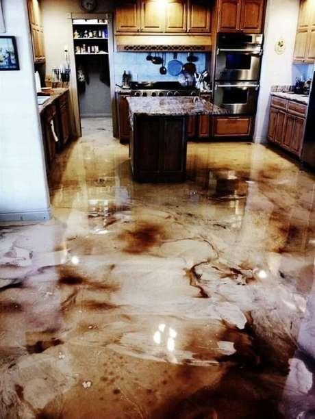 23 – Piso 3D aplicado na cozinha mesclando as cores branco e marrom. Fonte: Pinterest