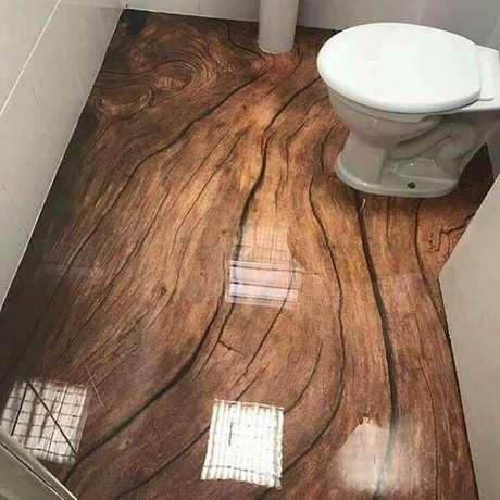 28 – Piso 3D com efeito amadeirado aplicado no banheiro. Fonte: Pinterest