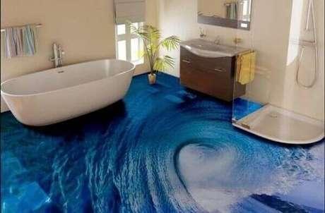 36 – Piso 3D imitando uma onda do mar aplicado no banheiro. Fonte: Porcelanato Líquido