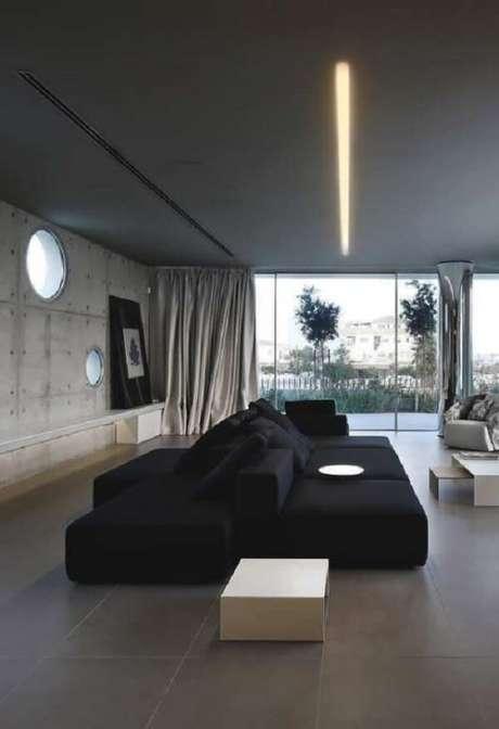 13. Ambiente integrado com sofá preto interligado com encosto. Fonte: Pinterest