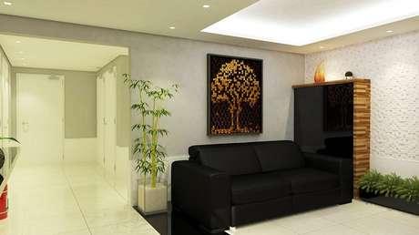 42. Sofá preto de 2 lugares compõem o projeto de decoração da sala. Projeto de Olavo Rosolem Guares
