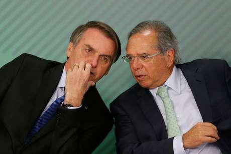 Bolsonaro e Guedes, em evento no Planalto  8/4/2019 REUTERS/Adriano Machado