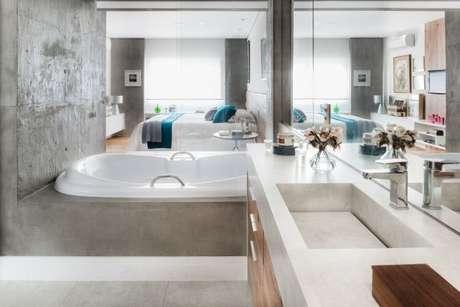 55. A suíte tem que combinar com as cores do quarto, use a cor cinza para sua decoração também – Foto: