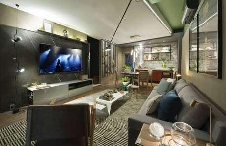 6. Decoração de sala com parede na cor cinza chumbo – Foto: Casa cor