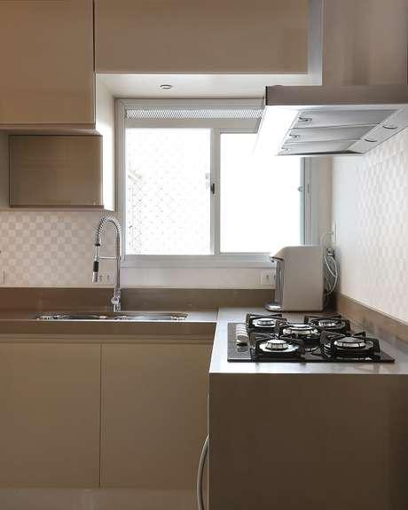 11. O cooktop foi instalado na cozinha em l. Fonte: Tua Casa
