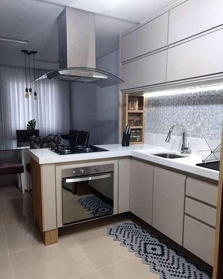 66. Cozinha em l permite a integração de ambientes. Fonte: Tua Casa