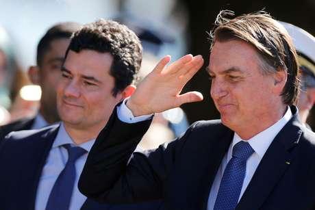Presidente Jair Bolsonaro e ministro da Justiça, Sergio Moro, chegam para cerimônia em Brasília 11/06/2019 REUTERS/Adriano Machado
