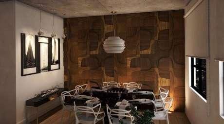 20. Veja na foto como você pode colocar lustres para sala de jantar em estilo moderno. Projeto de Rodrigo Veiga