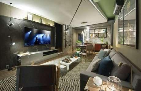 50. Painelpara TV em sala de estar integrada à de jantar. Projeto de Casa Cor Ceará 17