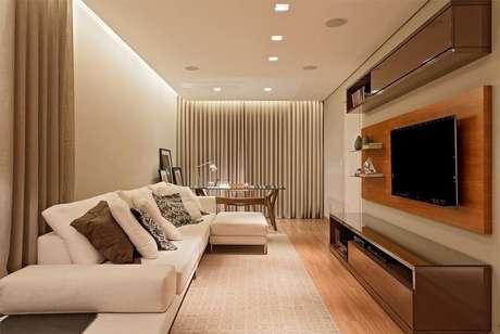 37. Sala com painel para TV edecoração impecável. Projeto por Leds Arquitetura