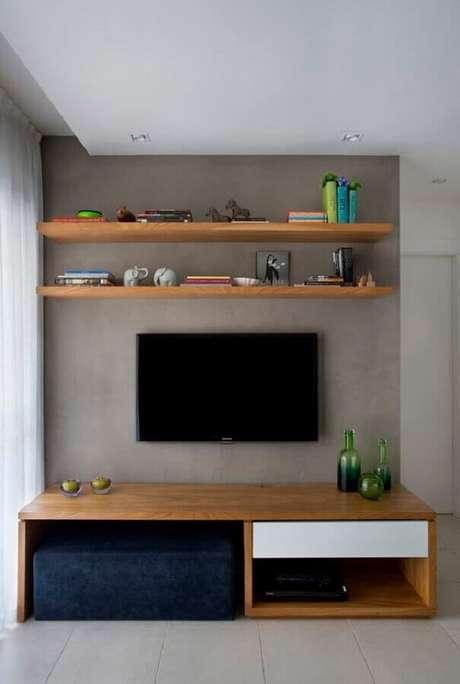 55. Prateleira de madeira para sala minimalista – Foto: Projetos Habitissimo