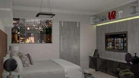 67. Nichos embutidos na parede também são exemplos da funcionalidade do quarto de casal moderno. Projeto por: Erica Ferreira