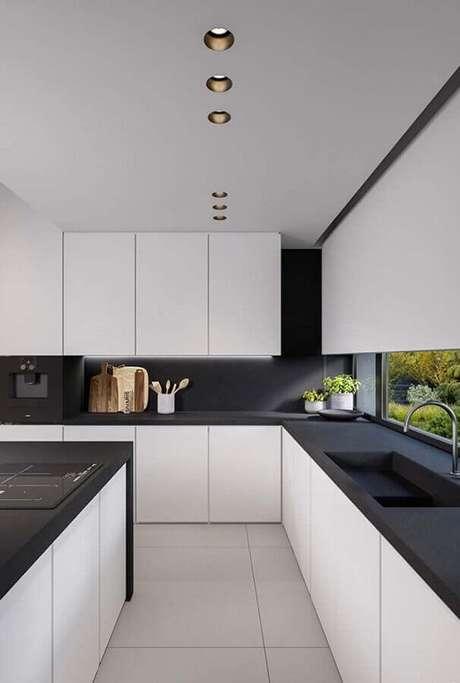 60. Design moderno para armário de cozinha branco com bancada preta – Foto: Casa é Melhor