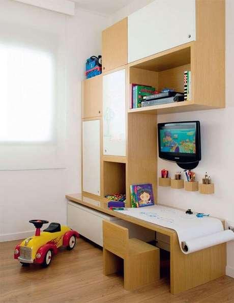 54. Modelos de guarda roupa infantil com mesa para atividades