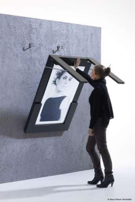 39. Mesa dobrável de parede para decorar a casa com um quadro