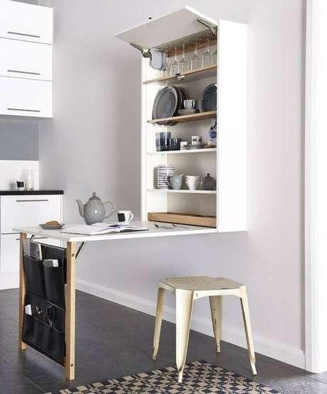 29. Mesa dobrável de parede com armário de cozinha