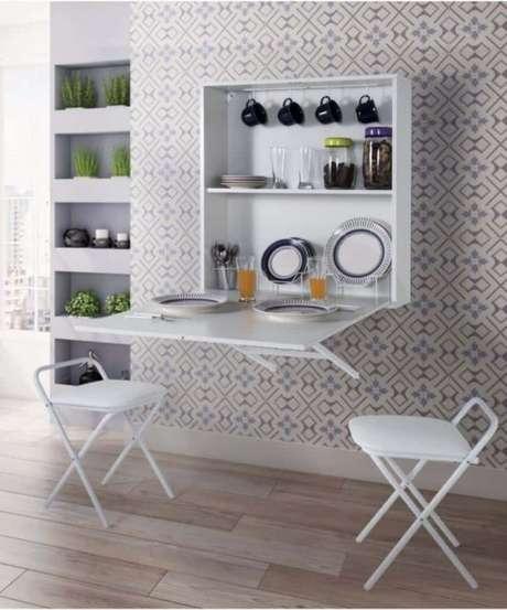 55. Mesa dobrável de parede com armário de cozinha