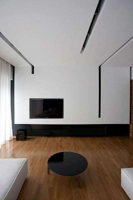 30. No ambiente contemporâneo a moldura de gesso acartonado tem os rasgos que se prolongam até a parede de Drywall. Fonte: Pinterest