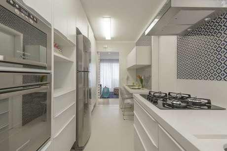 9. O cômodo pode ficar luxuosa com certos tipos de eletrodomésticos para cozinha. Projeto por: D2N Arquitetura + Interiores