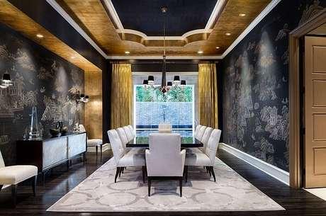 19. Decoração com dourado e preto encantam o ambiente da sala de jantar. Fonte: Pinterest