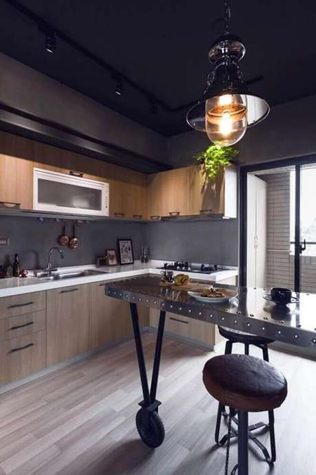 44. O cimento queimado é um modelo de revestimento para cozinha que está super em alta.