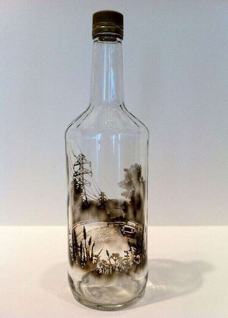 37. Garrafa de vidro decorado com fumaça de vela. Fonte: Pinterest