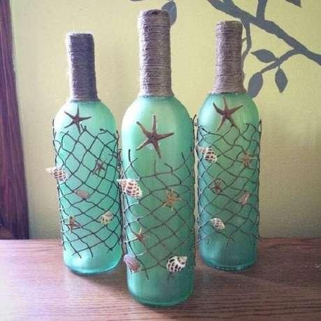 45. Garrafa de vidros decorados com estilo praiano. Fonte: Psiu Noiva