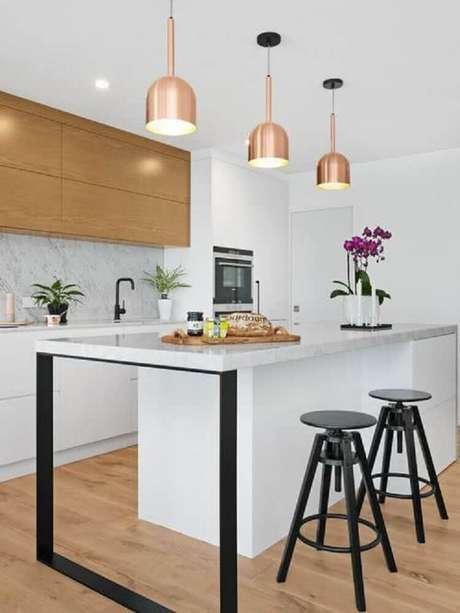 12. O mármore além de muito sofisticado, é um tipo de revestimento para cozinha que nunca sai de moda.