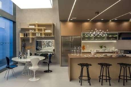 42. Decoração moderna para espaço gourmet integrado com cozinha – Foto: Revista Estilo Propio