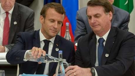 Macron (esq.) e Bolsonaro (dir.) em Osaka (Japão): presidente brasileiro 'desafiou' líderes europeus a respeito do desmatamento