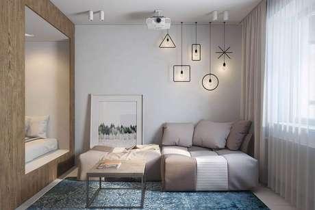 15. Os sofás camas modernos são excelentes opções para quem possui pouco espaço e adora receber visitas para passar um final de semana em casa – Foto: DIKA estudio